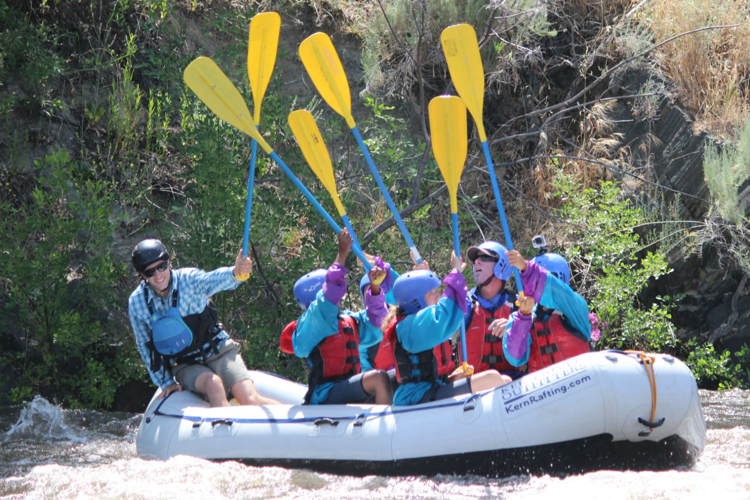 School group, paddle high five